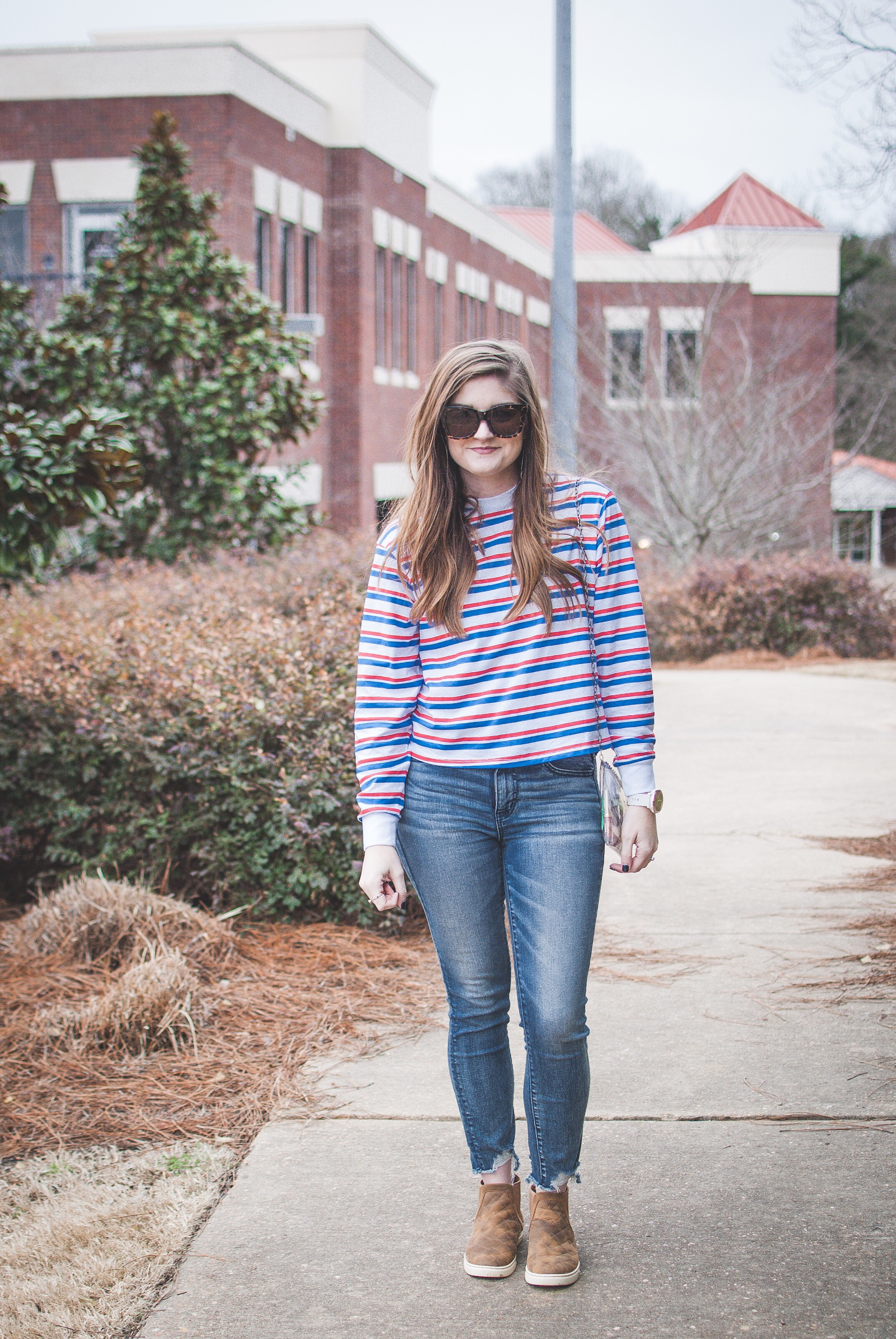 red and blue striped tee and jeans