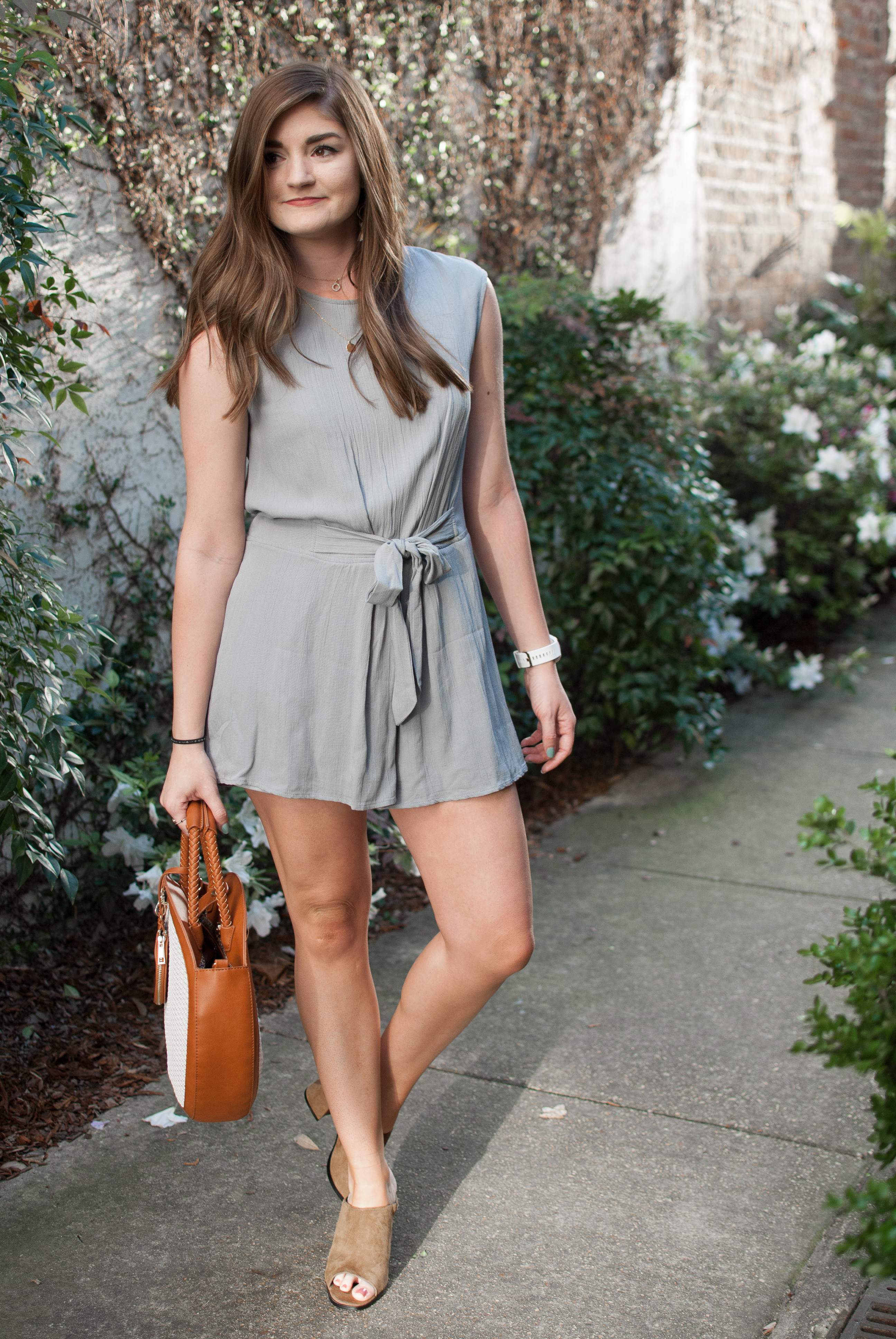 Grey romper and straw circle bag