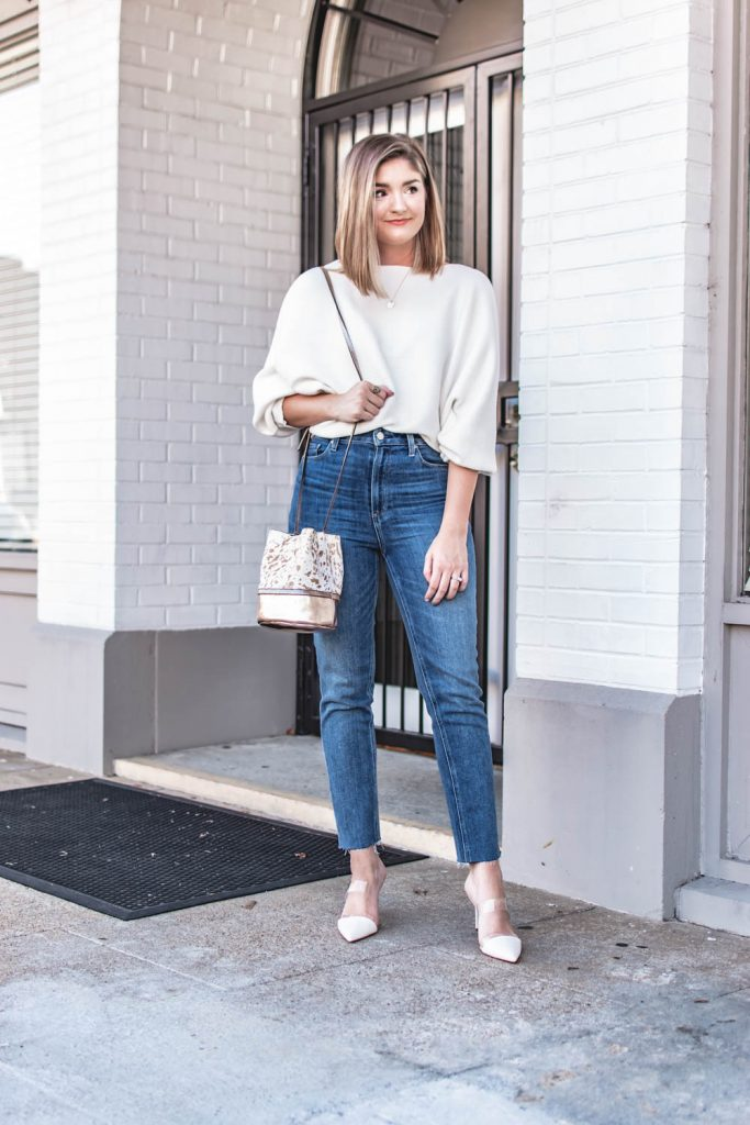 Wearing a $23 ribbed knit Amazon top paired with Paige jeans and white heeled mules.