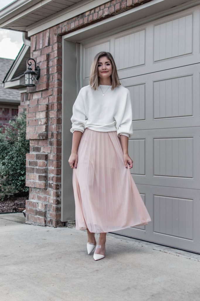 Wearing a $23 ribbed knit Amazon top paired with a blush pleated maxi skirt and white heeled mules.