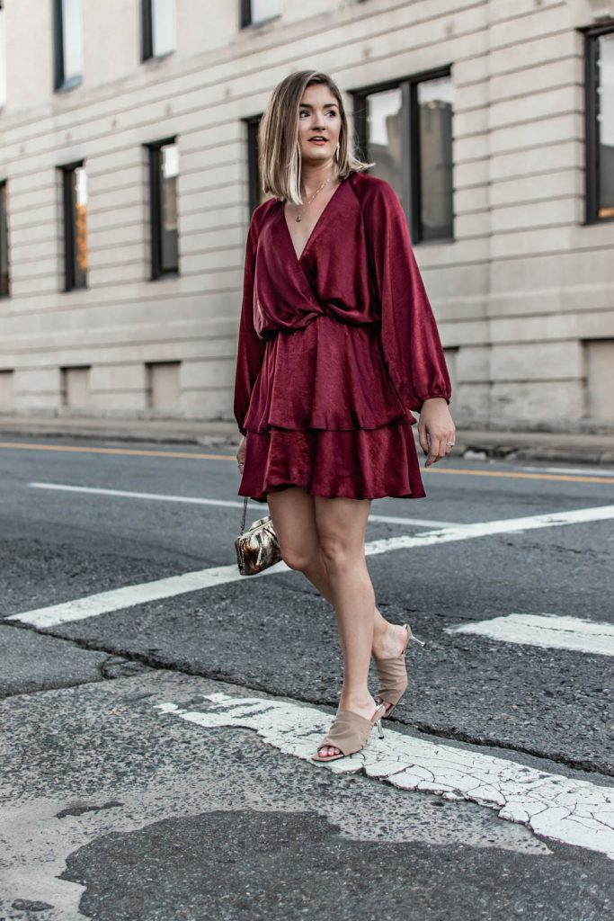 What to wear to a fall wedding. Wearing a burgundy, satin tiered dress from Zara.