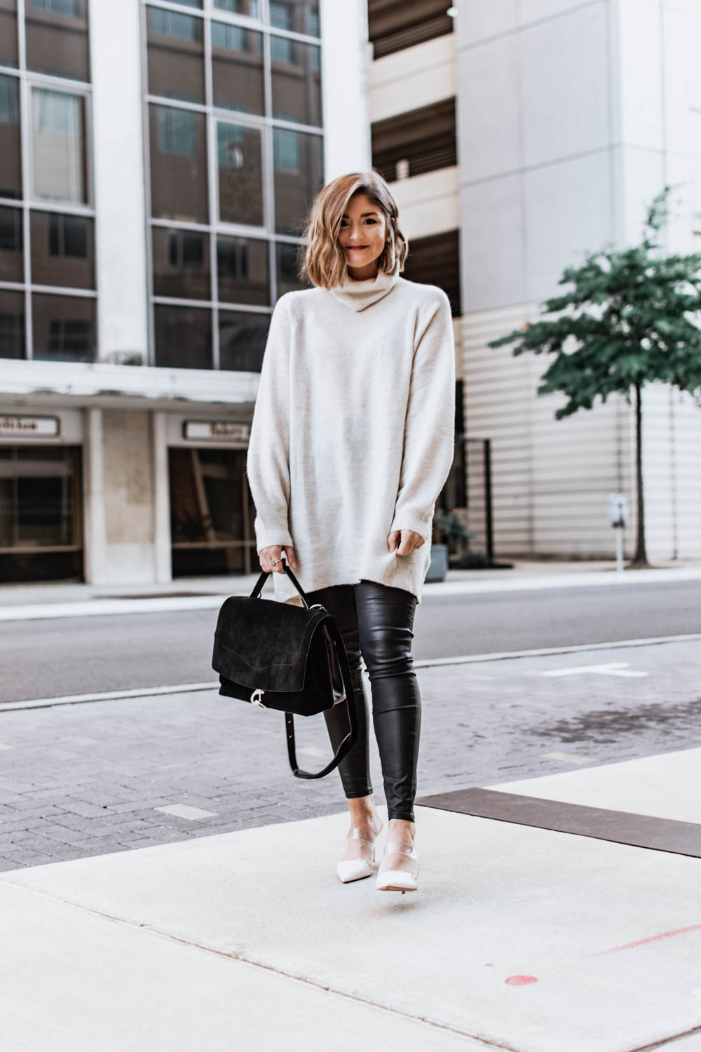 3 ways to wear a sweater dress this winter. Paired with faux leather leggings.